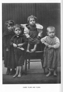 "image of four sad looking children, captioned ""cases 19,463 and 19,464"""